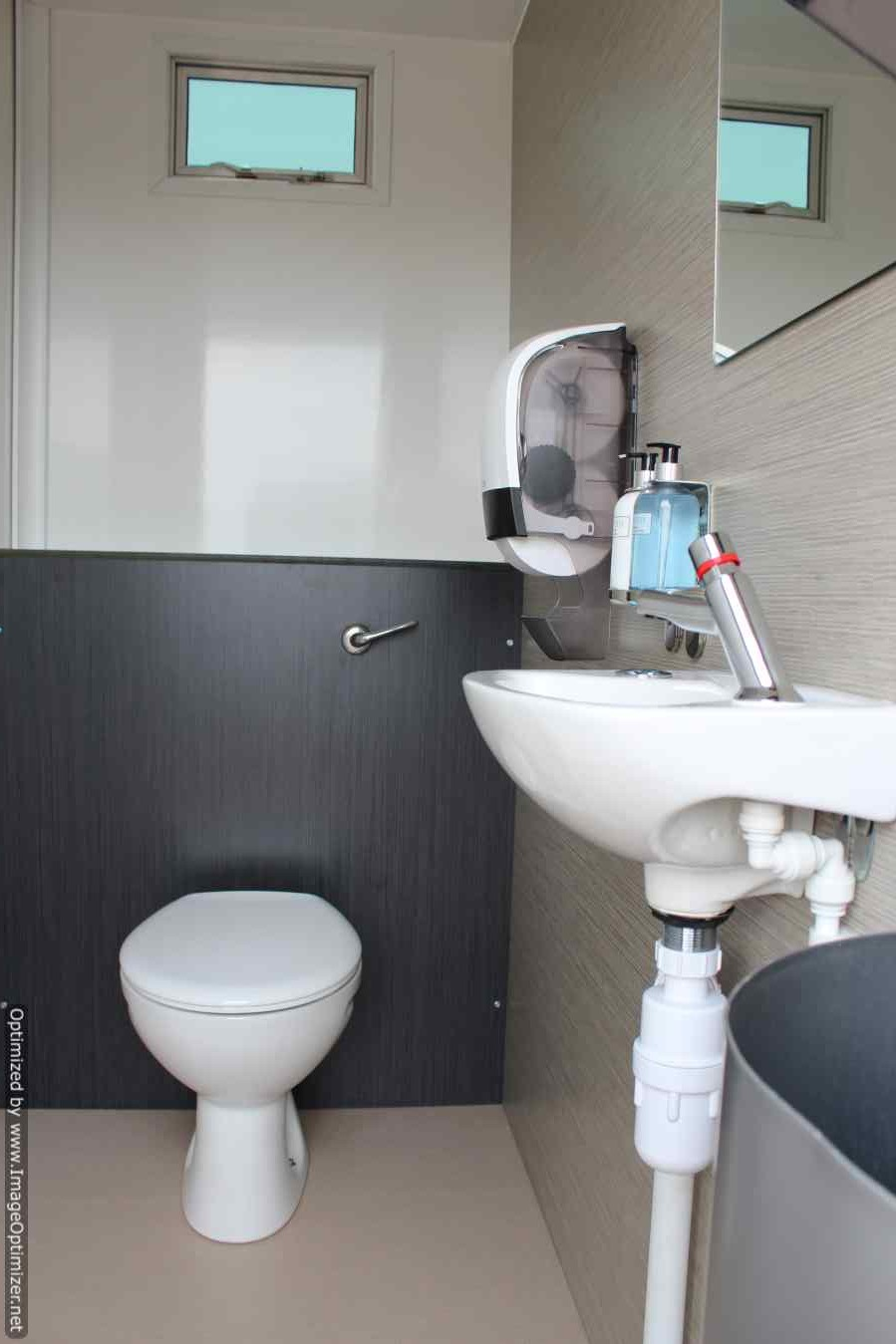 A bathroom with white and black walls.